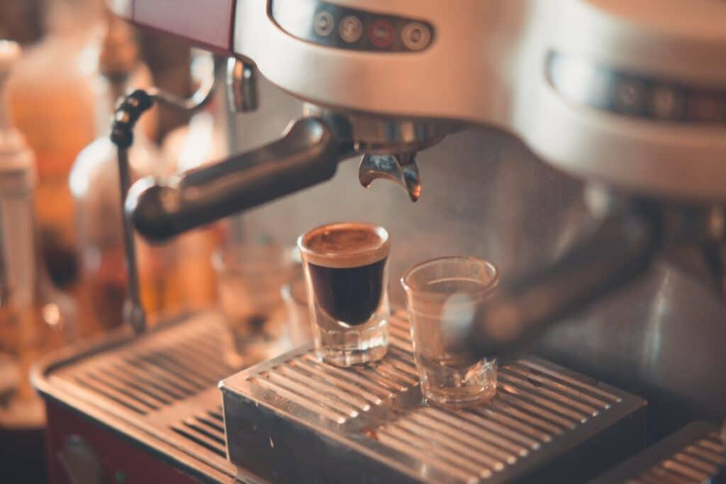selective focus photography of espresso machine